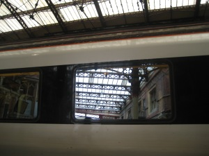 Roof structure reflected in a train window